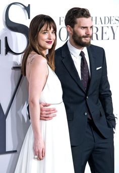 Jamie Dornan & Dakota Johnson on the grey carpet at the Fifty Shades of Grey UKpremiere in London - 12 Feb 2015Click on for more UK Premiere or Press Tour info orAppearanceslovefiftyshades.com | twitter | instagram | pinterest | youtube