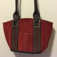 Tignanello suede purse Beautiful dark red and brown suede purse.   Brown leather handles.   Many pockets include two small ones outside of bag.  In perfect condition. Tignanello Bags Satchels