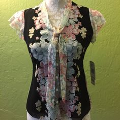 Flower silk blouse. Brand new, never wear Nine west beautiful flower blouse size 0 petite. 100% silk. Nine West Tops Blouses