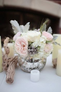 Blush and white with silver brunia berries and gray dusty miller. Nice wih periwinkle and gray.