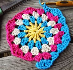 Give your granny square a new look with this How to Crochet a Hexagon tutorial! You won't believe how easy and quick this hexagon crochet motif is.  | AllFreeCrochetAfghanPatterns.com