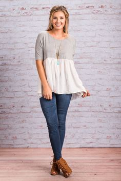 """""""Gonna Give In Top, Gray"""" You might be trying to hold out and save some money but this top will make you give in fast! It's jersey knit comfy top is wonderfully contrasted but the gauzey flowing bottom! #newarrivals #shopthemint"""