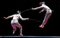 Ana Maria Popescu of Romania (right) competes against Anqi Xu of China during…