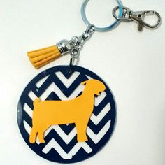 Boer goat keychain in FFA colors. Perfect for both boys and girls. Show your FFA show stock pride.