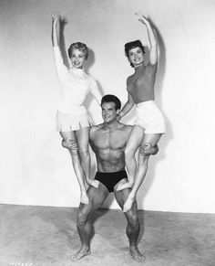 """Steve Reeves, Jane Powell and Debbie Reynolds a publicity photo for MGM's odd Physical Culture Musical, """"Athena."""" The girls' father ( Louis Calhern) runs a health food store, and he is a patron sponsored by the store in his bodybuilding efforts. Steve Reeves, Jane Powell, Classic Hollywood, Old Hollywood, Louis Calhern, Action Movie Stars, Photos Originales, Pumping Iron, Debbie Reynolds"""
