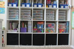 Confessions of a Homeschooler classroom setup 2012, love her tips for organizing  The Blue Organizer Bins are from Lakeshore Learning. The next row are one of my favorites. They are Small (10×11) Clear Document Cases from The Container Store. They house all of our manipulatives, math links, alphabet tiles, color cubes, lacing buttons, wooden shape blocks, etc, etc.