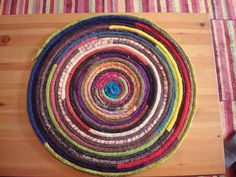 This is my Fun-a-Day NC project! Each day of February 2010 I knitted a length of i-cord with a different yarn left over from various past projects. I will sew it into a spiral as shown and then it will be a rug for Zoli.