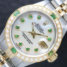 White Rolex with emeralds