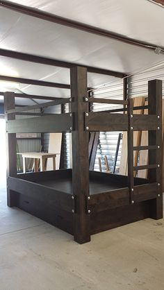 Custom Queen over Queen Bunk bed. Shown in Espresso Finish with silver hardware. This bunk bed features a full trundle and an integrated ladder at one end. Delivered and set up in Amarillo, Texas.