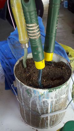 Fill an old paint can w/ SAND, not dirt.  Pour in a small can of oil.  Keep your garden tools in the sand. It works by keeping them clean and oiled (no rust).