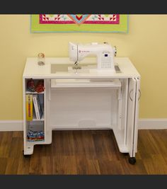 Arrow Mod Airlift Sewing Cabinet - Outfit your sewing space with the practical and polished Arrow Mod Airlift Sewing Cabinet . This sewing cabinet comes equipped with a three-position. Table Retractable, Sewing Machine Tables, Sewing Tables, Sewing Machines, Sewing Machine Cabinets, Sewing Desk, My Sewing Room, Sewing Cabinet, Cabinet Dimensions