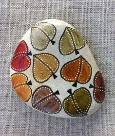 Hand painted stone. Leaves By: Rosana Green