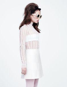 Alicia Vikander wears a Valentino Haute Couture dress in white with Matthew Williamson by Linda Farrow Gallery sunglasses