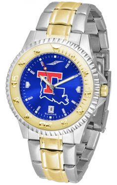 Louisiana Tech Bulldogs Mens Or Ladies Competitor Two-Tone Watch With Anochrome Dial. The ultimate fan's statement, our Competitor Two-Tone timepiece offers a classic, business-appropriate look. Features: 23kt gold-plated bezel stainless steel case date function. Secures to your wrist with a two-tone solid stainless steel band band complete with safety clasp. AnoChrome Dial Water Resistant 3 Year Warranty The AnoChrome dial option increases the visual impact of any watch with a stunning…