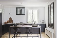 Spatial Code Kitchen with Nicolle Stools | Remodelista