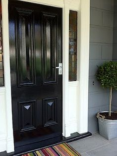 still debating painting our door black when we paint the house this summer. hmmm...