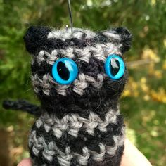 Adopt-a-Creature  Handmade and unique, Agent Perkins big blue eyes will keep you company in the dark!  He dreams of becoming a secret agent, but Agent Perkins cant tear himself away from the mesmerizing little red dot. He WILL catch it someday!  He will be shipped with his name and story on a personalized card!  ~~~~~~~~~~~~~~~  This little kitty can be delivered as EITHER A YULE TREE ORNAMENT, A PIN (see example in the photos), OR A KEYCHAIN....YOUR CHOICE!  He stands 2.5 high. Stuffed… Little Kitty, Little Red, Big Blue Eyes, Red Dots, Yule, Adoption, Ornament, Creatures, Dreams