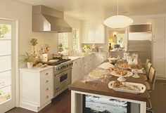 Tuscan kitchen -- traditional European country. Wood topped kitchen island.