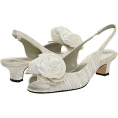Beautiful rosette detail poised over your pearly toes. Perfect for that knee length playful day wedding. J. Renee $61.99