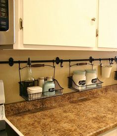 By hanging curtain rods and holders, you're able to eliminate the clutter on your kitchen counter. Easy clean ups! kitchen storage ideas, kitchen organizing ideas, DIY home decor ideas Küchen Design, House Design, Design Ideas, Interior Design, Diy Interior, Kitchen Interior, Room Interior, Modern Interior, Layout Design