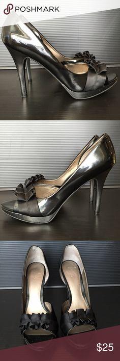 Carlos Santana Black Patent Leather Peep Toe Pump Black patent leather pump accent with a satin ruffle at the toe. Heel height approx 3.75 inches. Fits 9.5 to 10. Box unavailable. Carlos Santana Shoes Heels