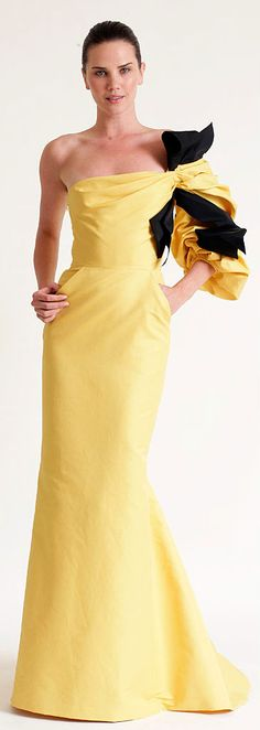 Carolina Herrera  loose the sleeve and the black contrast and just have the yellow off the shoulder with the brooch