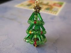 Christmas tree made of beads! How cute! Video tutorial for making a little beaded Christmas tree earring or pendant. (There's a wreath DIY too)