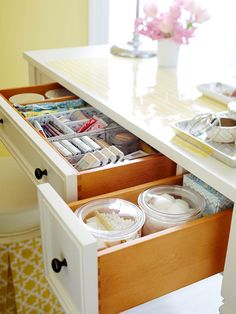 Corral disposable items in clear containers so they're easy to find and refill: http://www.bhg.com/bathroom/vanities/makeup-vanity-table-ideas/?socsrc=bhgpin060114drawerdivision&page=3
