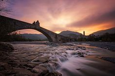 """Ponte Gobbo"" (Hump Bridge) also known as ""Ponte Vecchio"" (Old Bridge) or ""Ponte del Diavolo"" (Devil's Bridge) it's an ancient irregular bridge which crosses Trebbia river in Bobbio, near Piacenza..  ""Ponte Vecchio"" is 273mt long and has been named ""Ponte Gobbo"" because of its irregular arches (different each others) and their different heights.  (Source Wikipedia)  __________________________   Luca Libralato Photography  Luca Libralato On Facebook"