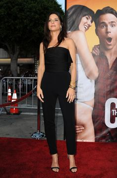 Sandra Bullock Jumpsuit - Sandra stepped out at the 'Change-up' premiere in a strapless black jumpsuit with a sleek silhouette. A gathered bodice and pencil legs made this look chic perfection.