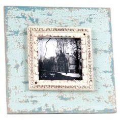 "Wood picture frame in weathered white and blue with nailhead accents. Holds one 4"" x 4"" photo.   Product: Picture frameConstruction Material: Wood and glassColor: Blue and whiteAccommodates: Holds one 4"" x 4"" photoDimensions: 8.25"" H x 8.25"" W"