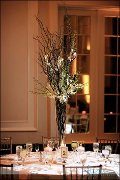 Centerpiece that we would like to avoid because too many branches and the branches go all the way down the clear vase