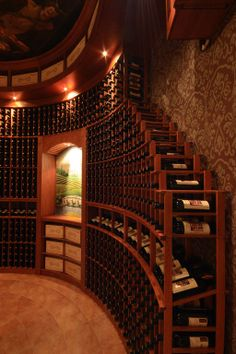 Beautiful rows of wine, gorgeous hardwoods and nice wine crates as a centerpiece