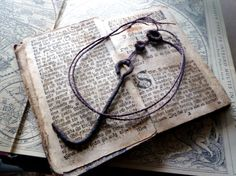 Necklace with rusty vintage hook and metal parts on handbraided brown cord by DreamSand on Etsy