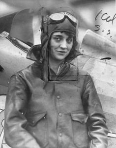 Aviatrix Blanche Noyes posing near her airplane in 1928.