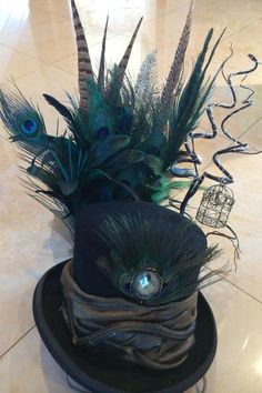 Whimsical top hat adorned with peacock feathers, birdcage and LED lights. High quality top hat made with the finest trims. Mode Steampunk, Steampunk Top Hat, Steampunk Costume, Steampunk Fashion, Victorian Fashion, Lace Bow Tattoos, Garter Tattoos, Rosary Tattoos, Crown Tattoos
