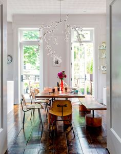 bright/wood dining room with Tord Boontje chandelier