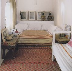 Love how the bed perfectly fits the space, but get that bench out of there.. and add maybe some brighter color?