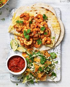 Griddled Bajan spiced prawn wraps with chunky tomato sauce Fresh prawns are cooked with tinned tomatoes, veggies and plenty of spice in this quick curry recipe. Stuff the mixture into warm flatbreads, top with natural yoghurt and tuck in. Prawn Recipes, Curry Recipes, Shellfish Recipes, Seafood Recipes, Quick Curry Recipe, Sandwiches, Farro Salad, Mexican Food Recipes, Ethnic Recipes