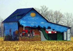 Art Barn   Art painted on 2 ends, 1 side, and half of the roof. Pig end faces east. Tractor in the field end faces west. Painted side faces north.  Location:  Rt 309 west of Rt 37 by 1.1 mile.  Marion Co - OH
