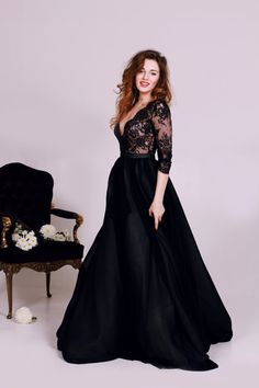 Black lace deep V-neck wedding dress with long sleeves / http://www.deerpearlflowers.com/unique-sophisticated-wedding-dresses-from-cathy-telle/3/