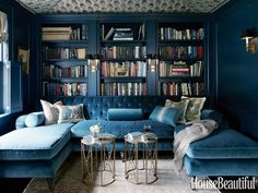 Woodwork is painted a deep, saturated color, Farrow & Ball's Hague Blue, and the ceiling is tented with a Michael S. Smith Indian block fabric, Jasper.