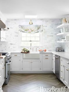 house beautiful; cwd remodel; love the herringbone floor. wonder if it is real wood, tile or laminate look-a-like