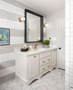 We used a classic subway tile for the walls in the bathroom, but instead of just using one color, we created a striped design using grey and white. The end result was a really cool feature that made this bathroom really unique.