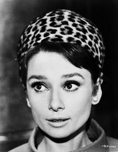 Audrey Hepburn rocks a leopard print scarf. #animalprint #leopardprint #fashion
