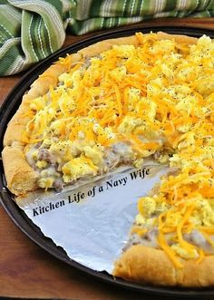 Breakfast Pizza for Dinner... 2 pkg Crescent Roll Dough 1 pkt Cooked Sausage Crumbles 1 pkt Country Gravy Mix 6 Eggs 2 T. Milk S&P to taste 1 T. Butter 12 oz shredded Cheddar... Preheat 375*F. Press 16 dough triangles on bottom and sides of greased pizza pan pointing toward center; Seal seams. Bake 11-13 min until golden. Make gravy. Add sausage; Set aside. Whisk eggs, milk, salt and pepper. Cook egg mix in butter on MED until almost set. Layer crust,/gravy/eggs/cheese. Bake 5-10 min. Serve.