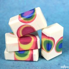 If gloomy February has you seeing grey, this Over the Rainbow Cold Process is sure to cheer you up. Made using the negative embed technique, this soap requires two steps. First, PVC pipes are inserted into the mold, and strapped down using large rubber bands. White soap is poured around the pipes and allowed to …