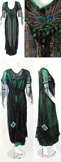 Tea gown, A.H. Metzner, New York, 1912. Emerald green silk with sheer black mesh net overlay, lace appliqués, faceted beading, and multicolored embroidery in peacock design. Flared kimono-style sleeves, asymmetric skirt-swag design, low-plunging neckline, and hook closures down back. Timeless Vixen Vintage/1st Dibs