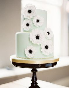 49. This mint beauty is covered in edible anemones, one of our favorite florals! See more of this black and mint wedding here captured by Ed Osborn Photography with cake by The Cake Parlour.