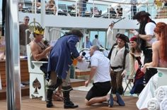 A pollywog begs for mercy from King Neptune during this Seabourn crossing the equator ceremony.